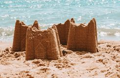 Sandcastles on the beach,vacation concept, toned. royalty free stock photo