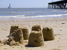 Sandcastles on a british beach. In summer Royalty Free Stock Images