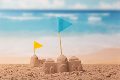 Sandcastles with checkboxes close-up on background of the sea. Royalty Free Stock Image