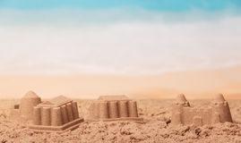 Sandcastles close up on background of the sea. Royalty Free Stock Photography