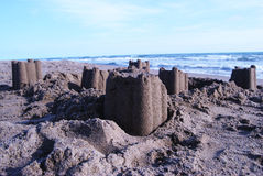 Sandcastles. On sea beach partly destroyed and at the dusk Royalty Free Stock Photos