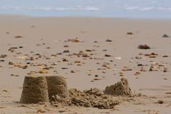 Sandcastles. With two knocked down on Bournemouth beach, Dorset, UK Royalty Free Stock Photography