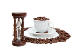 Sandclock and cup of coffee grains Stock Image