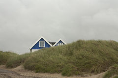 Sanddyn ger skydd Royaltyfria Bilder