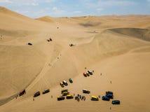 sanddyn med dynbarnvagnar arkivfoto
