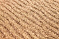 Sande auf dem Strand Stockfoto