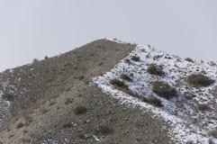 Sande und Schnee Lizenzfreie Stockfotografie