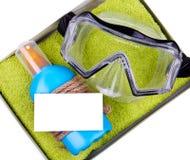 Sandelholze, Beutel, aufblasbare Jacke auf Sand Stockbild