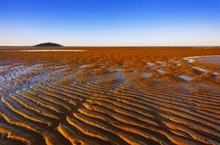 Sanden skvalpar Arkivfoton
