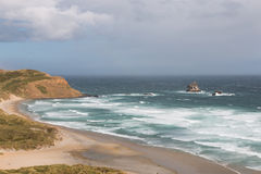 Sandfly Bay before storm stock image