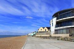 Sandgate beach Folkestone Kent UK. Sandgate beach promenade against nice blue sky with white cirrus clouds Folkestone Kent England UK royalty free stock photography