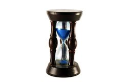 Sandglass. With blue sand on a white background Royalty Free Stock Images