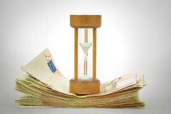 Sandglass and euros Stock Photo