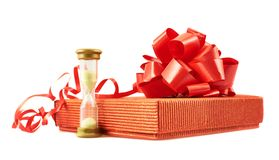 Sandglass and gift box composition isolated Royalty Free Stock Photography