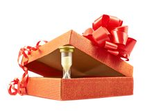 Sandglass and gift box composition isolated Stock Images