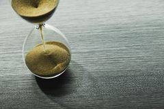 Sandglass, hourglass with sand. Time is running out. Speed of decision making in business Stock Image