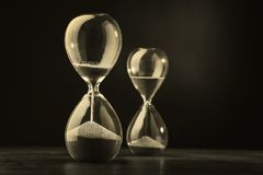 Sandglass, hourglass with sand. Time is running out. Speed of decision making in business Royalty Free Stock Photos