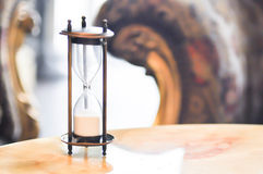 Sandglass or hourglass. On the table Royalty Free Stock Image