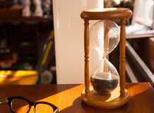 Hourglass, sandglass. Sandglass, hourglass on table near window Stock Images