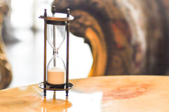 Sandglass on the table. Sandglass or hourglass on the table Stock Photography