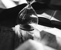 Sandglass on a table. Sandglass on a wooden table Royalty Free Stock Image