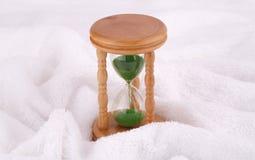 Sandglass on towel Royalty Free Stock Image