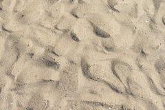 Sandhintergrund mit Abdrücken Stockfotos