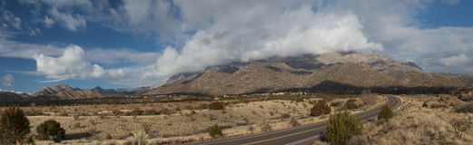 Sandia Mountains Panorama. A true, wide panorama of the Sandia Mountains, just east of Albuquerque, New Mexico, with the last clouds of a winter storm hovering Royalty Free Stock Photos