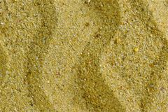 Sandig bakgrund för idérik design och kreativitet Sand består av korn av vaggar, främst små partiklar av kvarts, silikon, arkivbilder