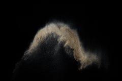 Sandig explosion som isoleras på svart bakgrund Arkivfoton