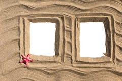 Sandig photoframe för par Arkivfoto
