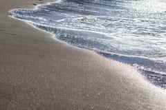 Sandig strand Arkivfoto