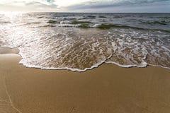 Sandig strand för hav Arkivfoto
