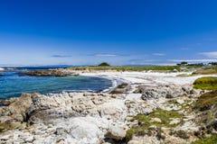 Sandig strand nära cypresspunkt Royaltyfri Bild
