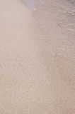 Sandig strand, slut upp Arkivbild