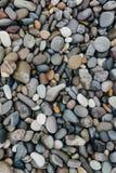 Sandig strand Texturera av stenarna Arkivfoto