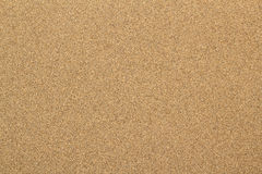 Sandig strandbakgrund texturerar Royaltyfria Foton