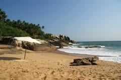 sandig strandett slags solskydd hav Arkivfoton