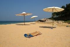 sandig strandett slags solskydd hav Fotografering för Bildbyråer