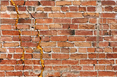 Sandig tegelstenvägg Fotografering för Bildbyråer