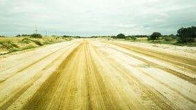 Sandiga vägspår i Mocambique Fotografering för Bildbyråer