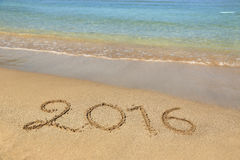 2016 sandigen Strand geschrieben Stockbilder