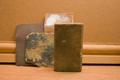 Sanding block and used sandpaper. Stock Image