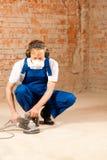 Sanding the cement floor Royalty Free Stock Photo
