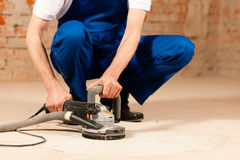 Sanding the cement floor Royalty Free Stock Photo