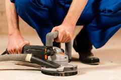 Sanding the cement floor Royalty Free Stock Photos