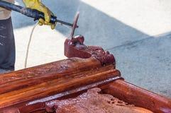 Sanding a chair. Craftsman sanding a handmade chair Stock Images
