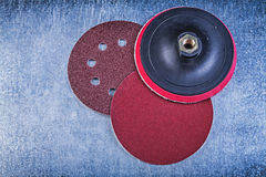 Sanding discs holder on metallic background directly above Royalty Free Stock Images