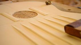 Sanding a guitar structure, close up Royalty Free Stock Photos