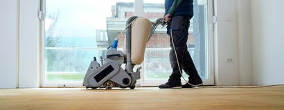 Sanding Parquet With The Grinding Machine Royalty Free Stock Photo